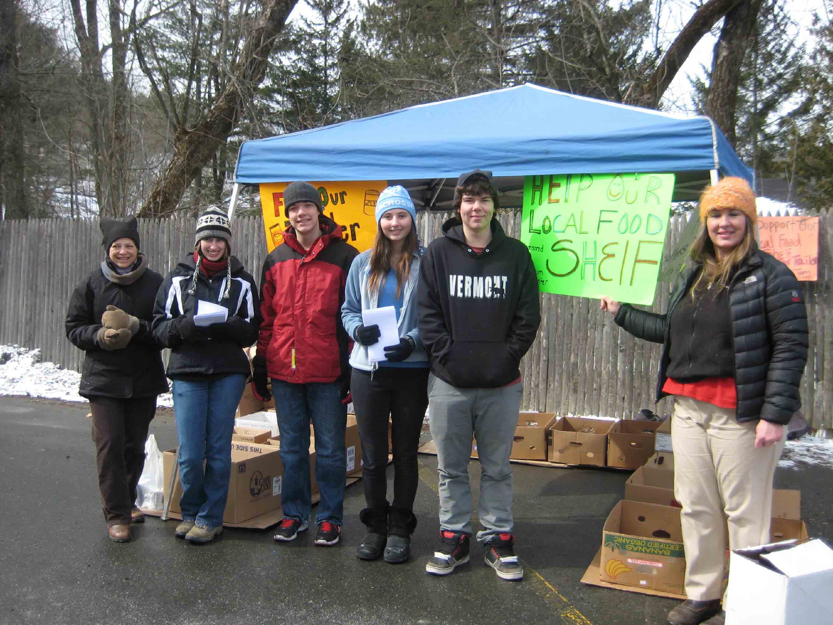 left to right: Joan Williamson, Treasurer WCFS; students Carolyn Hopkins, Kent Dalton, Megan Dalton, Evan Sawyer, and Joni Kennedy, Adult Advisor, collect food at mac's Market in Woodstock on March 16, 2013.