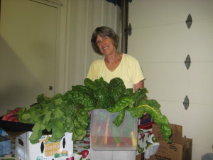 Anne Dean brings produce from her garden